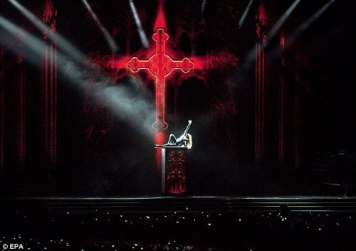 The show began with a red (bloody) illuminated crucifix bearing the letters MDNA - an acronym strangely similar to MDMA, another name for ectasy a drug that is very popular on dancefloors across the world.