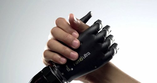 This artificial limb company probably paid a good chunk of change to have its product featured in the video. It is also there because it perfectly synchs with the robotic-dehumanized theme of the video.