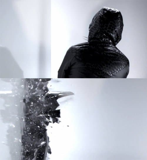 In this apparently random scene, an unknown hooded person smashes into a wall and breaks in multiple pieces. Does this represent a MK slave fragmenting in multiple personalites?