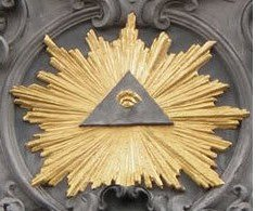 The Eye of Horus inside a triangle (symbolizing deity) surrounded by the glow of Sirius, the Blazing Star