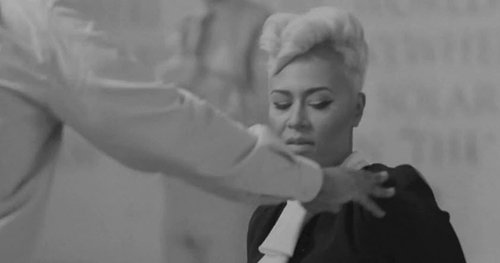 "As a man steps up to Emeli, she gives a look saying ""Why you touching me for?"""