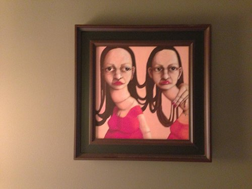 A very creepy painting above the bed depicting two girls with dead eyes and deformed, elongated necks. Does this image represent split personalities?