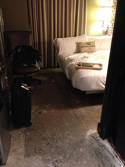 The floor is hard, dirty concrete, unlike any other room in the hotel.