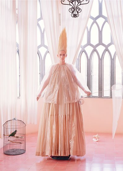 I'm not gonna lie. Tilda Swinton creeps the hell out of me. Her recent photoshoot in W magazine fully exploited that creepyness, took it to another level and, to make things extra headache worthy, the shoot is permaeated with MK/Illuminati symbolism. Here's Tilda looking extra weird next to birdcage (symbol used to represent Monarch slaves). She apparently caught the bird herself. Why Tilda? Why?? Let the bird live!