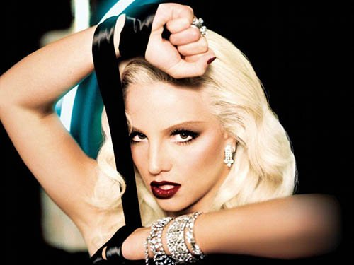 "Britney ""channels"" here Marilyn's platinum blonde look. Her hands are bound which can represent her state in the entertainment industry."