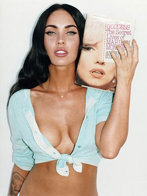 Megan Fox is here poses with a book on Marilyn Monroe and showing off her Monroe tattoo.