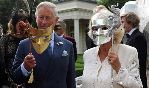 Prince Charles and Duchess Camilla wearing similar Venetian masks  in the gardens of Clarence House.