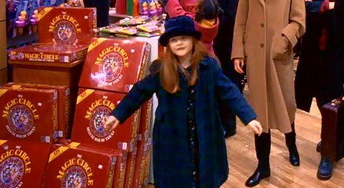 "The last scene of the movie takes place at a toy store - a place full of highly symbolic details. Here, Helena walks by a toy called Magic Circle - hinting that there's a link between the occult underworld and the ""real world"". However, most people have their ""eyes wide shut"" to even realize it."