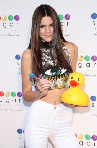 Here's Kendall holding a rubber ducky. Also, mostly, she is showing that the industry has an eye on her. Literally.