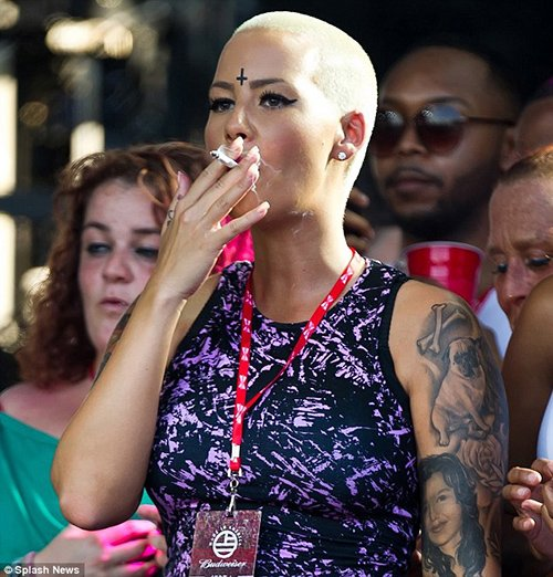Amber Rose (Wiz Khalifa's wife) attended the Made in America music festival with an inverted cross stamped on her forehead.