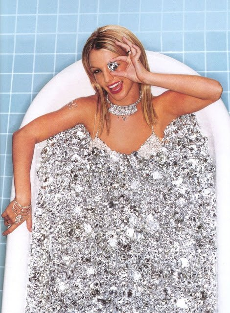"Speaking of Kitten programming, here's a rare photo of Britney Spears from 2000. She is literally bathing in diamonds which is coincidentally the symbol used to indentify ""presidential models"", the highest level of Kitten Programming. Of course, she is hidding one eye to make sure we understand what's going on there."