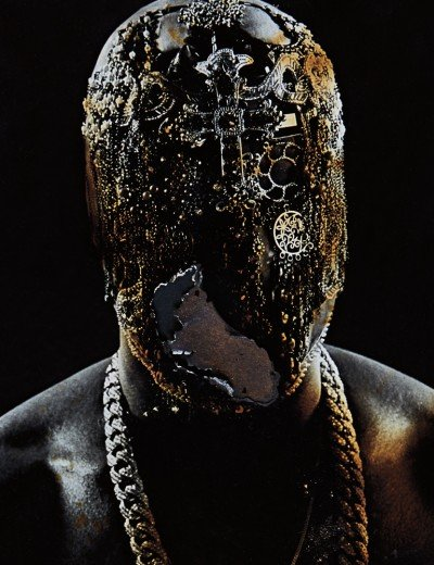 Kanye wearing the world's most elaborate mask which features one hole for one eye. More MK symbolism.