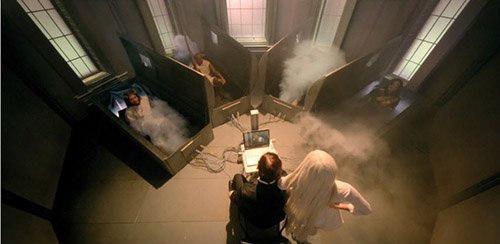 Gaga enters a room containing four tombs connected to a computer. From them emerge Jesus Christ, Gandhi and Michael Jackson.