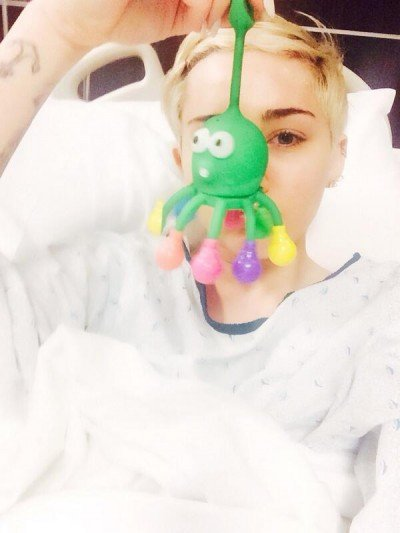 Miley Cyrus got hospitalized and was forced to cancel a few shows. That did not stop her to post a one-eye pic, as if she was programmed to do so.