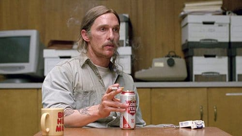 "In the ""present day"" scenes, where Cohle is discussing his investigation with detectives, Cohle drinks cans of beer and smokes cigarettes - aluminum and ashes. Is this a way of saying that, after years in the ""psychosphere"" that Cohle is now completely imbued with it?"