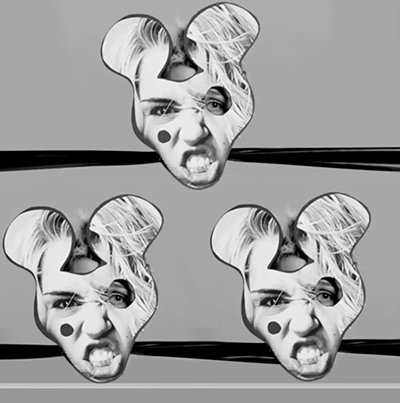 For a split second, Miley's heads are covered with a mask bearing Mickey Mouse ears (a symbol representing MK programming). Also, one of the eyes is cut out the classic sign of the Illuminati entertainment industry.