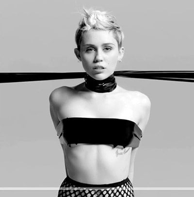 This image represents Miley in the music industry: Restrained, held at the neck by unseen people with hands tied behind her back.
