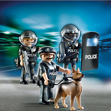 "Playmobil's ""City Action"" series features cops in riot gear with shields and gas masks holding big guns, clubs and dogs ready to bite the face off of protestors. All part of the agenda of normalizing a violent, oppressive police state."