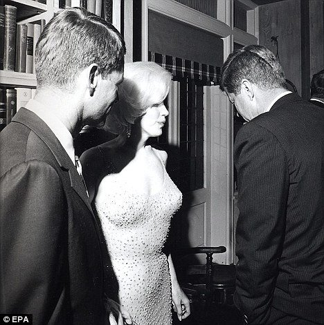 "Marilyn Monroe speaks with John F. Kennedy after famously singing him ""Happy Birthday Mr. President"". Wearing her iconic diamond-studded dress (diamonds are associated with Presidential Models in MK symbolism), the song was actually a Beta Kitten sensually singing to the man she is servicing."
