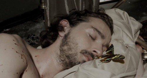 Shia then wakes up with a butterfly next to his head, hinting that programming was completed.