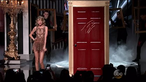 Someone is knocking at Taylor's red door (which was scratched by someone who attempted to escape but died horribly). Who could that be?