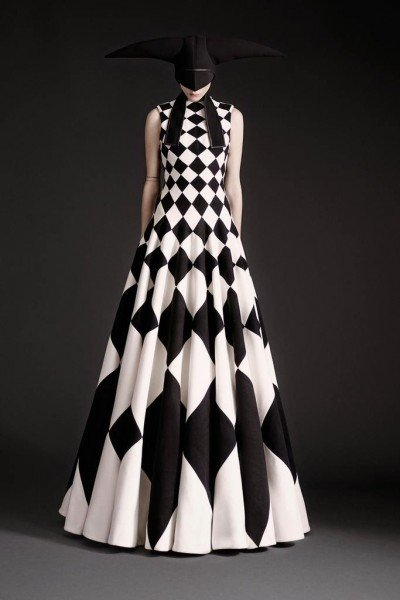 This dress features a checkerboard pattern similar to Masonic floors. The model is hoodwinked, the same way Freemasons are hoodwinked during initiation.