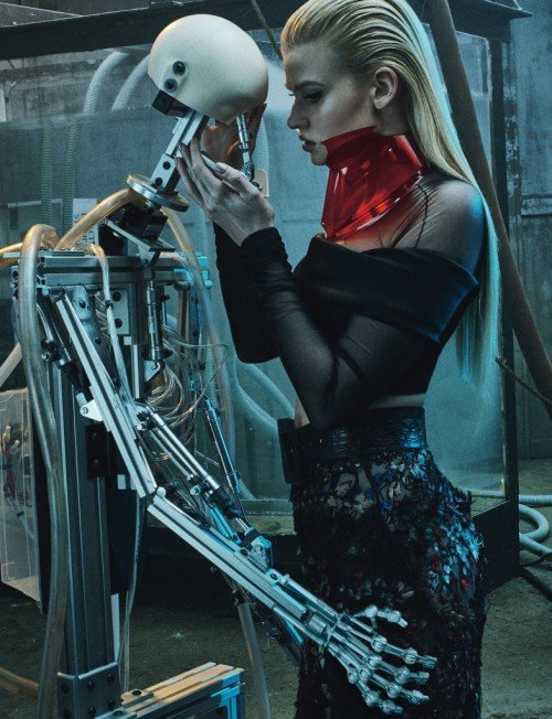 Should someone tell that model that this robot is not alive and won't kiss her back? She does not seem to understand the difference between robot and not robot person.