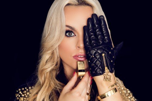 "Katy Tiz got signed with a major label and released her single ""Whistle While you Work it"". The image for the single is all about her giving salute to her elite overlords."