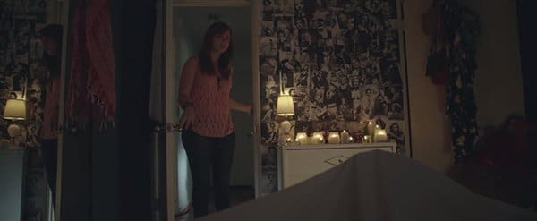 "Back home, Sarah's roommate finds her lying in bed with a creepy candle-lit shrine to past movie stars who went through the same ""transformation"" as her."