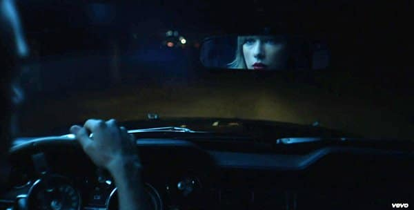 When he looks at the rear view mirror, he sees Swift, indicating that, despite being the alter that is triggered, he is still physically Taylor Swift.