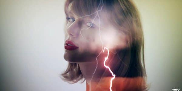 A lightning bolt goes through Taylor's head. This can be a reference to electroshock torture, which is often used in mind control to cause dissociation.