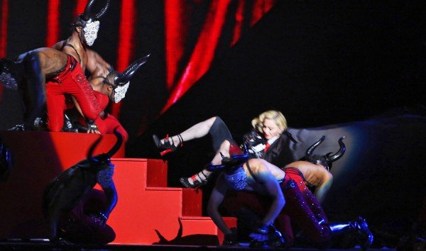"Madonna ""choking on her cape"" at the Brit Awards trying to do what the elite requires her to do in order to stay relevant."