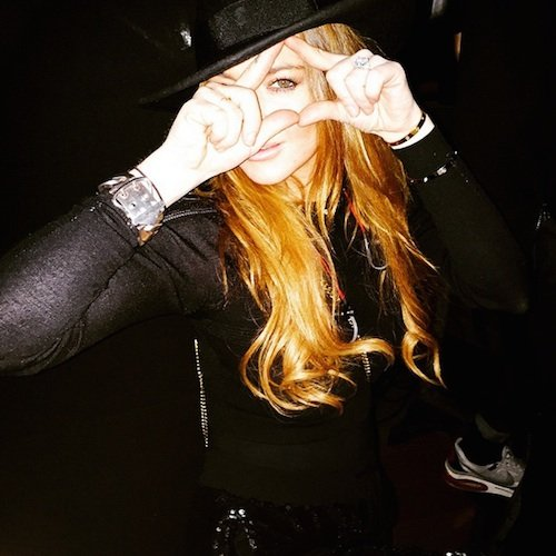 Speaking of one-eye, the sign appeared in a whole bunch of places around the world in the past few weeks. Here's Lindsay Lohan (you might be an actual Beta Kitten) doing the All Seeing Eye inside a triangle at a Kanye West concert. She was so proud of this picture that she posted on Instagram.