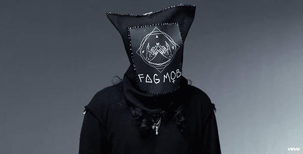 Some of these young rebels wear a sac over their heads saying Fag Mob. Its logo looks like a black magic sigil mixed with the coolness of the middle finger.