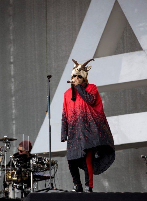 After looking like Jesus for a while, Jared Leto performs with horns on his head while his band's logo - stylized pyramid with a capstone - is in the background. The same symbols exist around the entire entertainment industry.