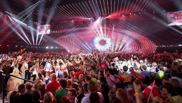 Eurovision 2015 is one of those countless contests around the world to find the next industry puppet. Throughout the show, a gigantic eye stares at the extatic crowd (and the people at home), letting us know who is behind this kind of crap.