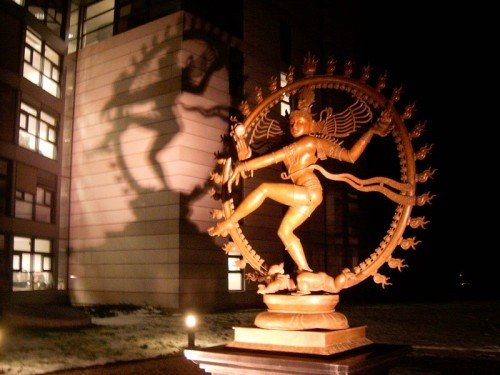 "This statue of Hindu god Shiva stands at the entrance of CERN, where the large hadron collider was reactivated. Shiva is also known as ""The Destroyer""  - his duty is to ""destroy worlds at the end of creation and dissolve them into nothingness"". This is a strange addition to a scientic building, but not the only strange symbolism associated with CERN."