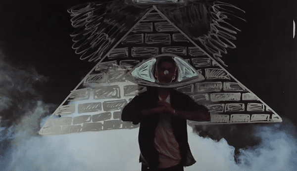 Biebers face is the pupil of a big Illuminati pyramid.