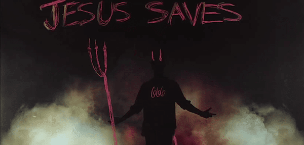 "An ironic ""Jesus Saves"" with Bieber portrayed as the devil with 666 on his chest. As a self-professed Christian, I am not sure Bieber approved of that slide. But he unfortunately has no power over whatever is projected on him - in this video and in real life."