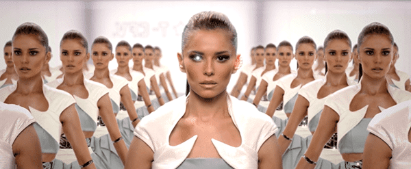 Cheryl Fernandez-Versini is a robot with hundreds of duplicates ready to be used. At one point, a light flashes from a single eye, telling you that this is about Illuminati mind control.