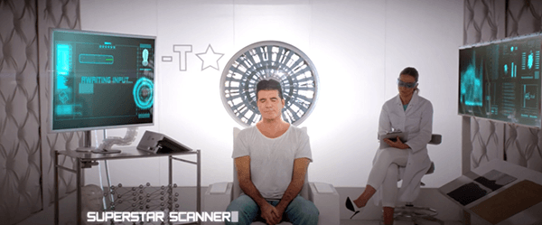 Simon Cowell is having is thoughts scanned while a scientists takes notes.