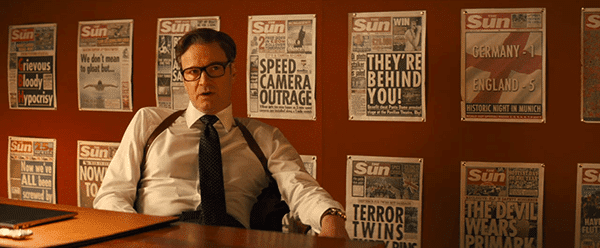 Behind Gallahad are the covers of newspapers after Kingsman accomplished something major - and they're all stupid, sensationalist stories that have nothing to do with them. Media is used to distract the masses while they're kept in the dark from the truth.