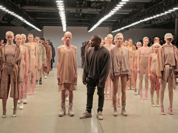 Kanye West is fashion designer now. His fashion show featured people looked as if they were about to die, wearing miserable (but expensive clothes). Instead of marching to music, they were marching to militaristic orders. Is this post NWO fashion?