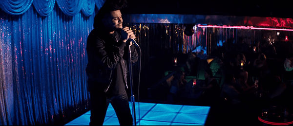 The video begins with The Weeknd singing his little song in a club, doing his little dance moves.
