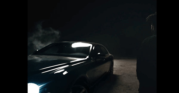 The Weeknd enters a black car and rolls towards ... the hills?