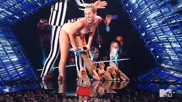According to Miley, the impact she had on the VMA is when she became America's #1 Sex Kitten when she got raunchy with old-ass singer Robin Thicke.