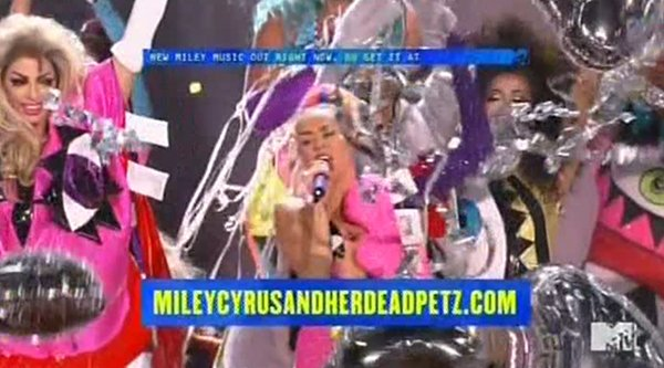 Miley announces that her album is availalbe online. The name of that album? Miley Cyrus and her Dead Petz.