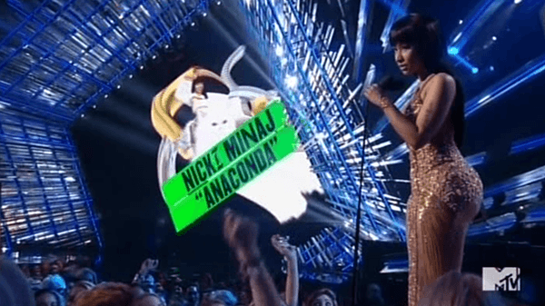 "First Nicki gets an award for her video ""Anaconda"" which is basically a Beta Kitten theme song. When she gets on stage, the screen behind her displays Nicki ridding a kitten."