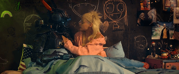 Yolandi in bed with Chappie as she reads him a story.