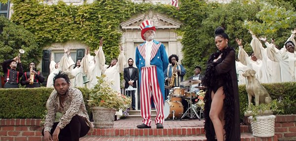 The first shot of the video For Free? represents the unholy triangle of Kendrick needing to 'marry' Uncle Sam in order to please gold diggers like the lady on the right.